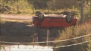 The car being removed from the lake on Tuesday