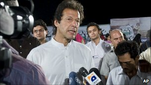 Pakistani cricketer-turned-politician Imran Khan during his visit to collect donations for flood victims in Islamabad on 29 August 2010