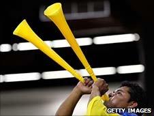 A fan blowing two vuvuzelas