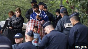 French police evacuate a Roma family from an illegal camp in Mons en Baroeul, near Lille, northern France, on 26 August, 2010