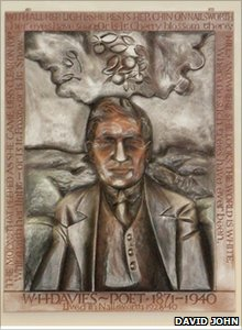 Wood carving of WH Davies by David John