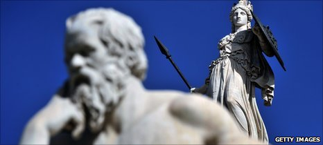 Statues of Greece's ancient goddess Athena (R) and ancient philosopher Socrates outside Athens' Academy
