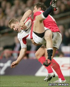 Gavin Henson tackles rival centre Matthew Tait of England during Wales' 2005 Grand Slam campaign