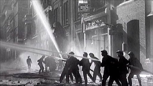 Firefighters tackle a fire during the Blitz.