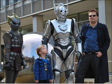 Kristian and Tony Bennett with a Silurian and Cyberman from Doctor Who