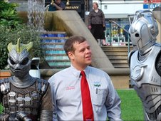 City centre ambassador Mickey Barnes with a Silurian and Cyberman