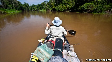 Person in canoe on river in Bolivia