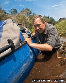 Chris Smith pushing the canoe