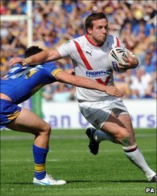 Bryn Hargreaves holds off Leeds' Chris Clarkson during the Challenge Cup semi-final