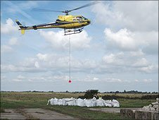 Helicopter carrying rocks
