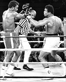 George Foreman (L) and Muhammad Ali (R) during the 'Rumble In The Jungle' fight in 1974