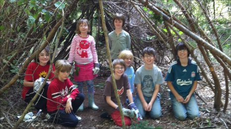 Children learning bushcraft skills