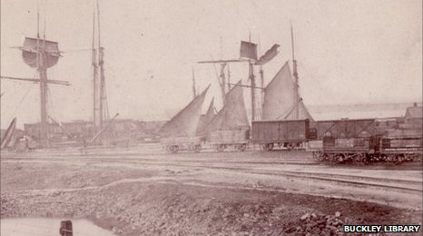 Boats and railway carriages on the dock at Connah's Quay port, date unknown