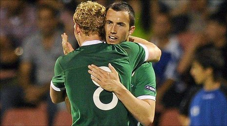 Paul Green celebrates with Republic of Ireland scorer Keith Fahy
