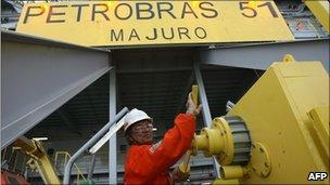 A worker aboard the Petrobras P-51 off-shore oil platform