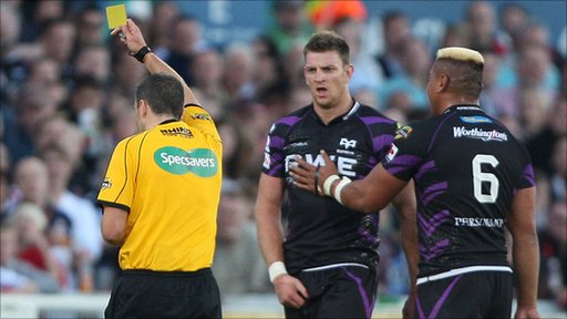 Ospreys captain Jerry Collins (right) consoles Nikki Walker as he is sent to the sin bin in the Ulster v Ospreys game