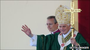 Pope Benedict XVI waves as he celebrates Mass in Italy, 4 July 2010