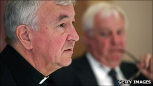 Lord Chris Patten (right) looks on as Archbishop Vincent Nichols speaks during a press conference in London, 5 July 2010
