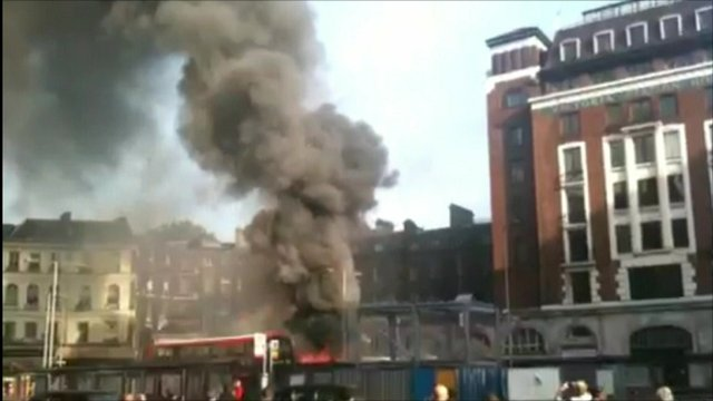 Bus on fire outside Victoria Station