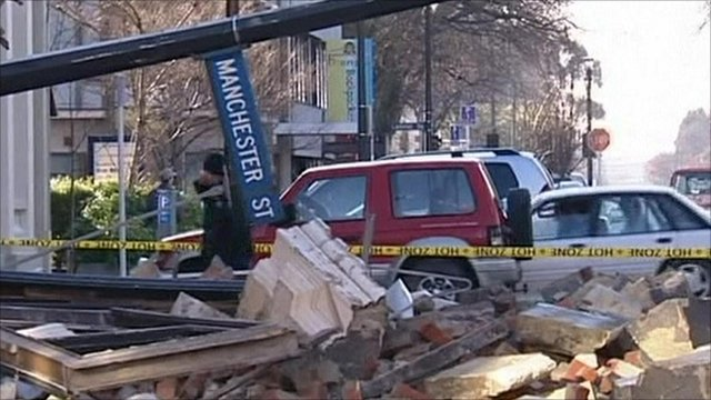 Rubble and toppled street sign in Christchurch