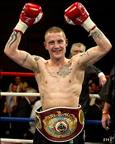 Ricky Burns poses with the WBO super-featherweight belt