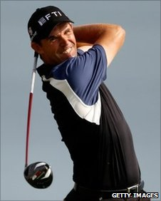 Golfer Padraig Harrington hits a tee shot