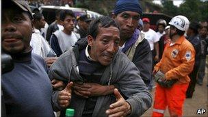 Manuel Sohom Ixmata mourns a relative lost in a landslide in western Guatemala