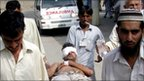 On a stretcher, an injured victim of a suicide bombing in Lakki Marwat on 6 September 2010