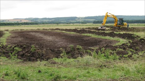 A digger levelling out spoil from a newly dug wader scrape at Potter Brompton Carr. Copyright: Tim Burkenshaw