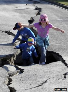 Children play in a damaged road in Christchurch (6 September 2010)
