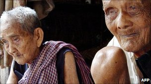 Sek Yim, right, 120, and his wife Ouk, 108