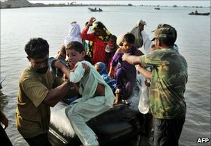 Pakistani soldiers help flood affected villagers from boats in Khairpur Nathan Shah in southern Sindh province
