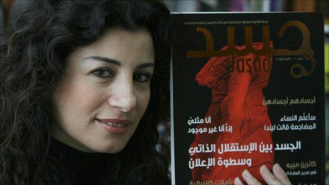 Joumana Haddad holding a copy of Jasad