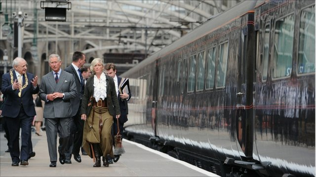 Prince Charles, Prince of Wales boards the royal train at Glasgow Central station