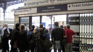Passengers at Victoria Tube station