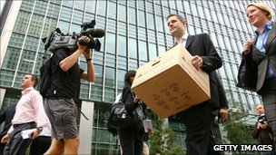 Lehman Brothers' employee carries his belongings away from the bank after its demise in September 2008
