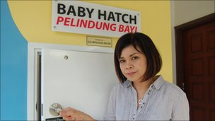 Noraini Hashim of Orphancare demonstrates the baby hatch