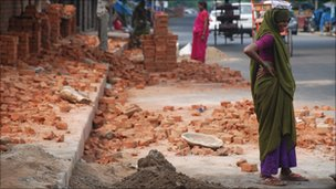 Female worker next to brickmakers