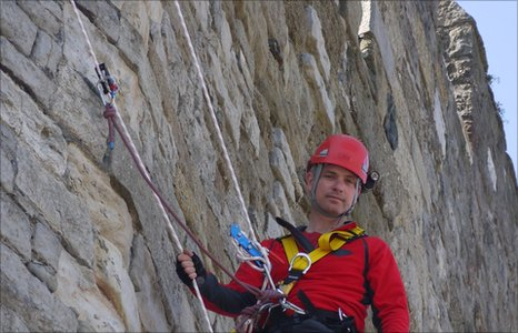 Dr Jonathan Foyle climbing Caernarfon Castle