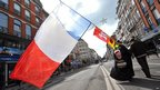 A demonstrator with a France flag in Lille, northern France