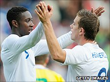 Danny Welbeck (left) and Jordan Henderson celebrate after a goal against Lithuania
