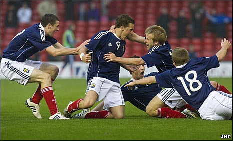 The Scots celebrate Chris Maguire's late winner