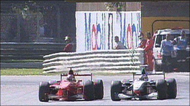 Michael Schumacher overtakes Mika Hakkinen