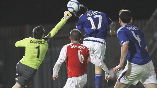 Cliftonville keeper John Connolly at full stretch to deny Linfield striker Curtis Allen at Windsor Park
