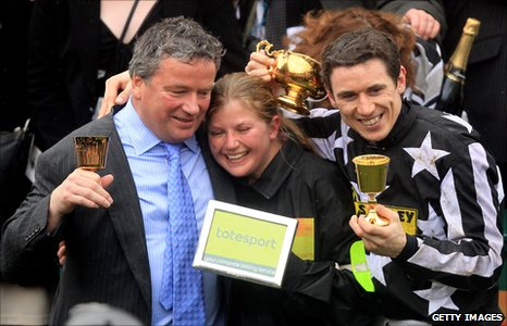 Trainer Nigel Twiston-Davies (L) celebrates his Gold Cup win with jockey Paddy Brennan (R)