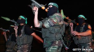 Masked Palestinian fighters of the Ezz El-Den al-Qassam Brigades