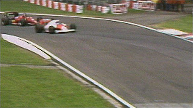 Alain Prost overtakes an ailing Stefan Johansson