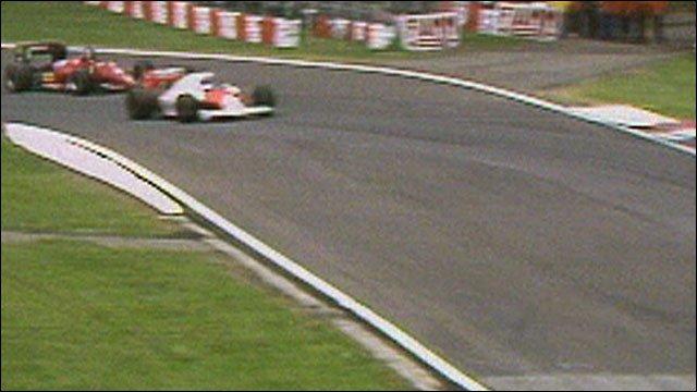 Alain Prost overtakes an ailing Stefan Johansson