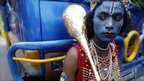 A young man dressed as Krishna in Dhaka