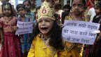Child dressed as Krishna crying in Ahmadabad, India